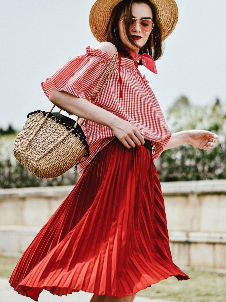 red-pleated-midi-skirt-gingham-off-shoulder-top-pink-gucci-horsebit-loafers-straw-bag-hat-pink-tinted-sunglasses-bandana-andreea-birsan-couturezilla-cute-spring-outf-2687040-750x1000
